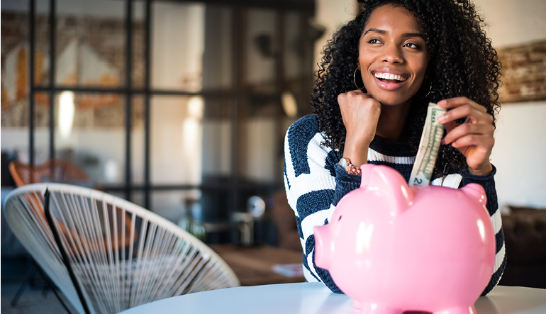 happy-woman-saving-with-piggy-bank