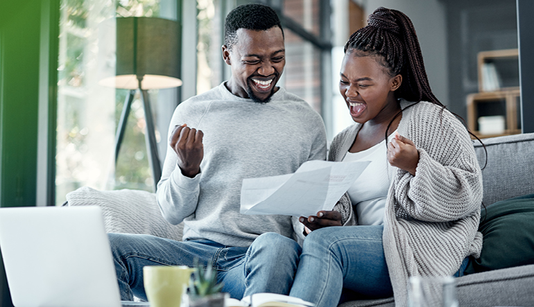 happy-couple-reviewing-their-finances