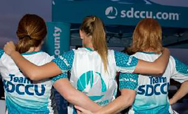 three women in team sdccu shirts