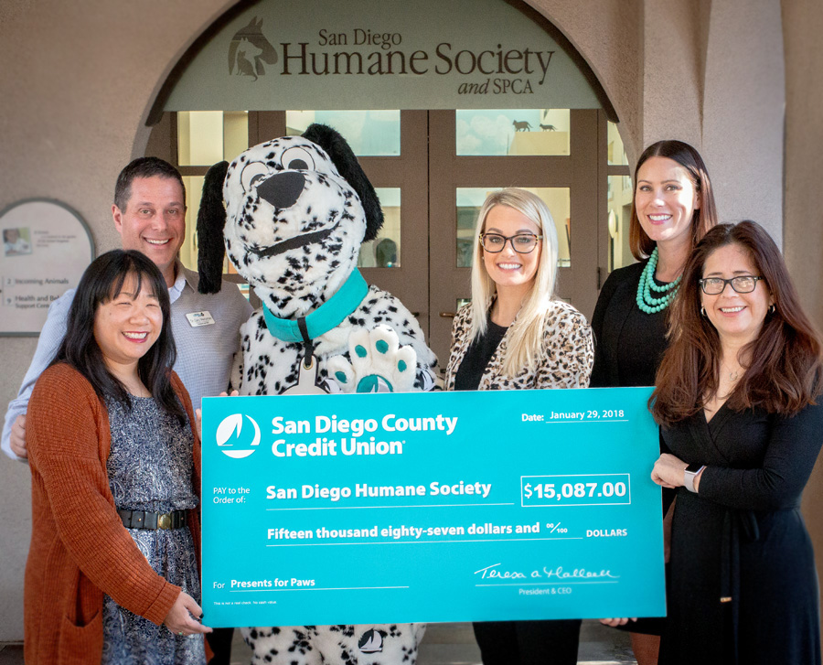 sdccu employees present check to san diego humane society