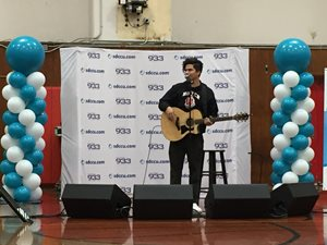 alex aiono playing guitar at sdccu high school takeover
