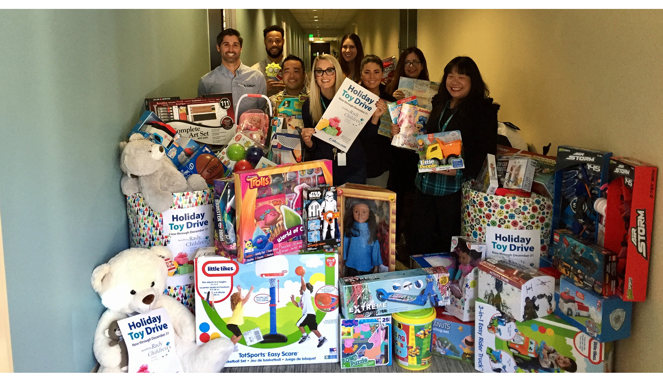 sdccu staff with collected toys for children's hospitals