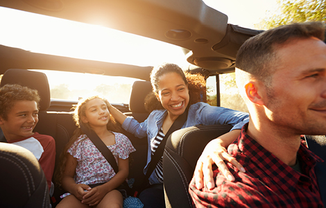 happy family in the convertable car bought with sdccu auto loan